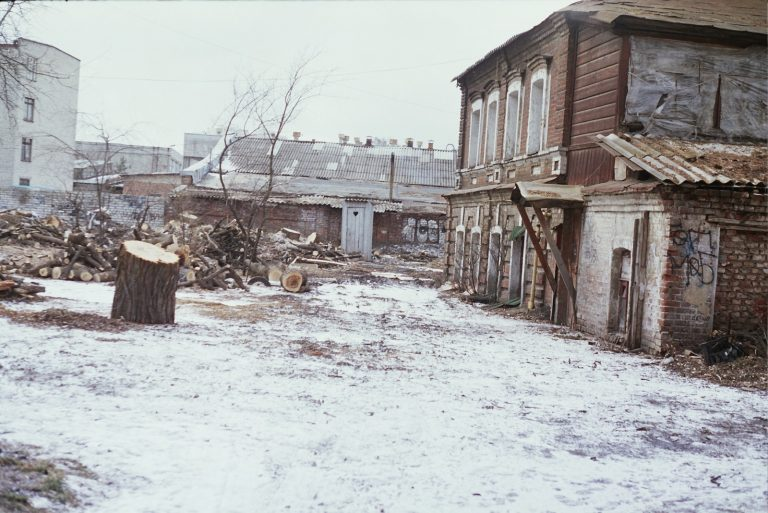 brown wooden houses on snow covered ground during daytime
